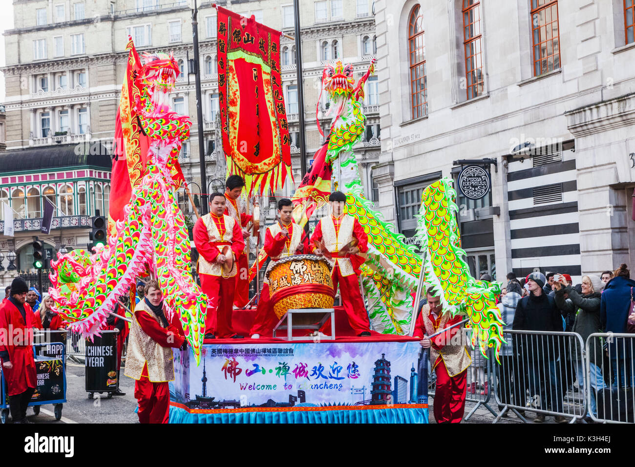 England, London, Chinatown, Chinese New Year Parade, Festival Float and Spectators - Stock Image