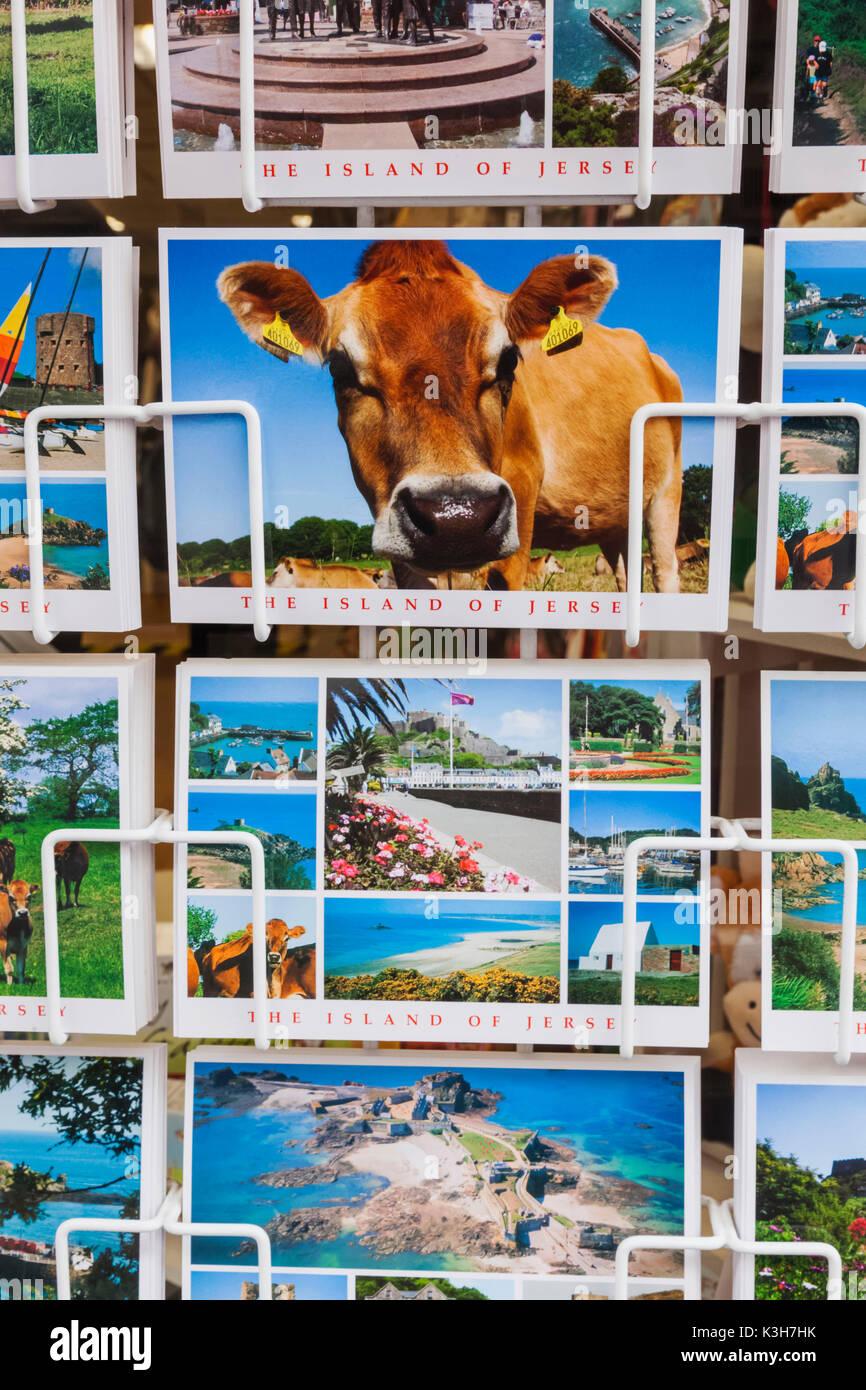 United Kingdom, Channel Islands, Jersey, St.Helier, King Street, Souvenir Shop Display of Postcards - Stock Image