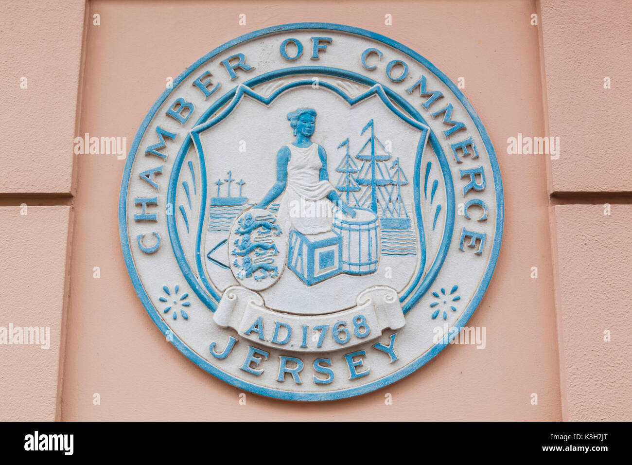 United Kingdom, Channel Islands, Jersey, St.Helier, Blue Plaque on Wall of The Chamber of Commerce Building - Stock Image