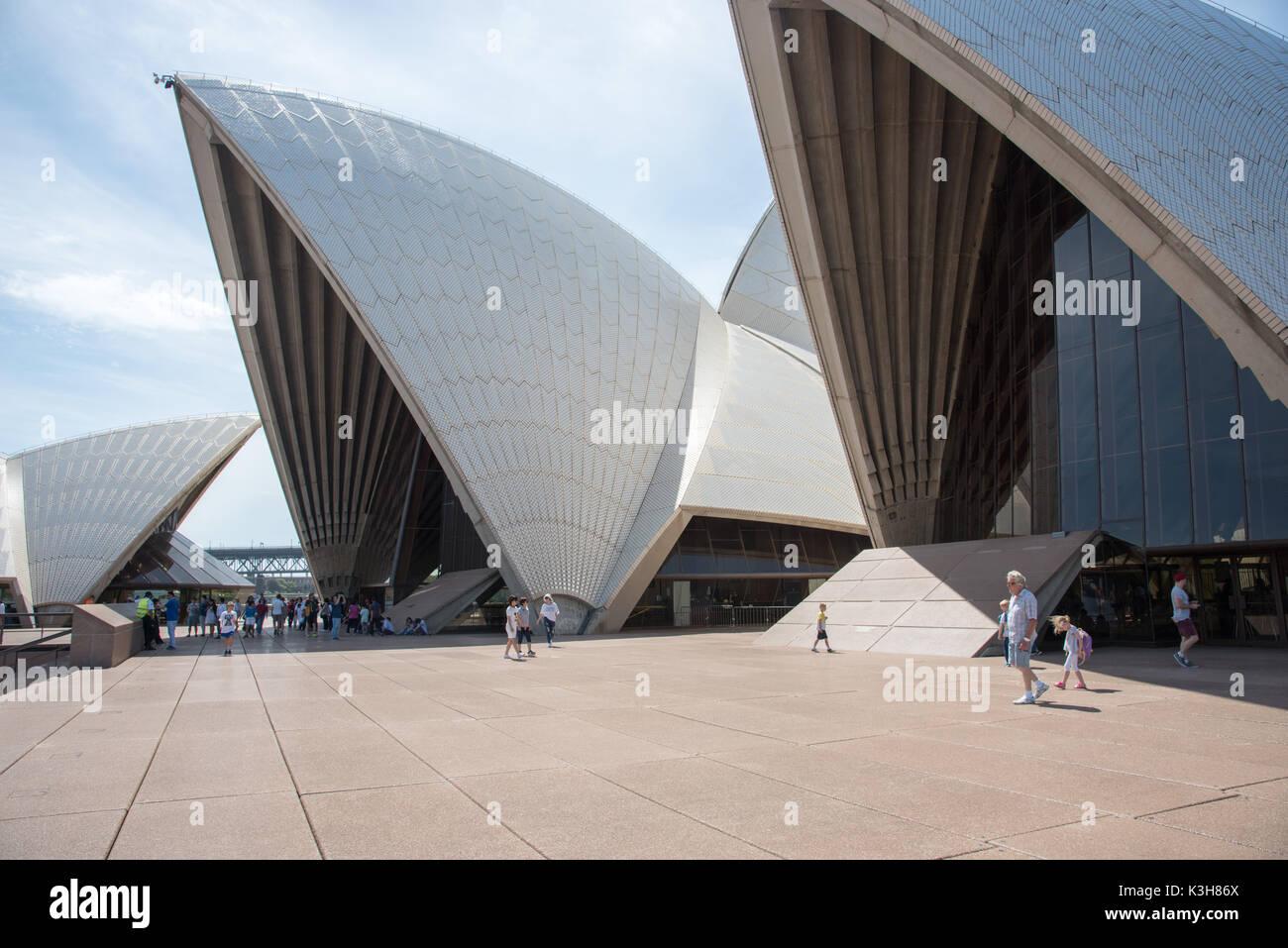 SYDNEY,NSW,AUSTRALIA-NOVEMBER 20,2016:Tourists outside the Sydney Opera House with precast concrete chevron pattern roof in Sydney, Australia - Stock Image