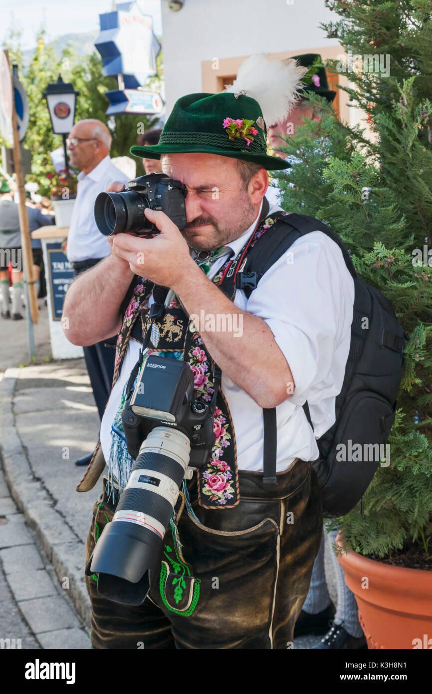 Germany, Bavaria, Garmisch-Partenkirchen, Bavarian Festival, Photographer Dressed in Lederhosen - Stock Image