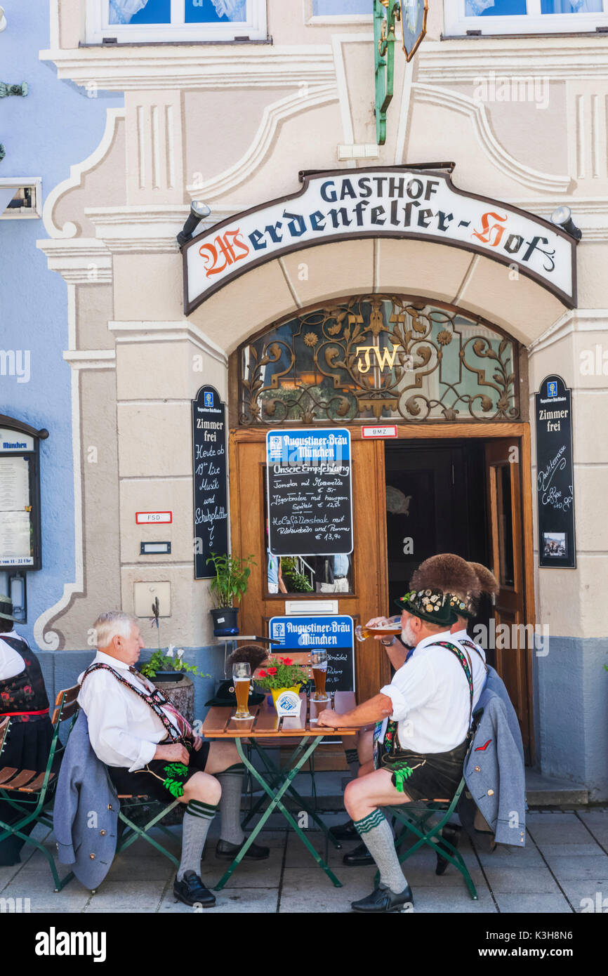 Germany, Bavaria, Garmisch-Partenkirchen, Hotel Restaurant with Diners in Traditional Costume - Stock Image