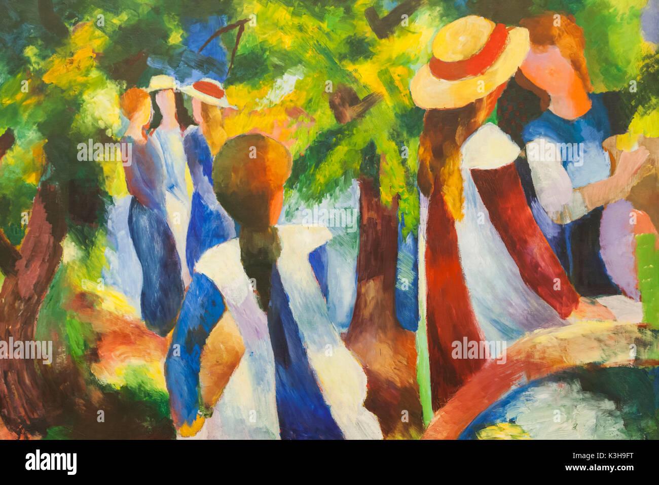 Germany, Bavaria, Munich, The Pinakothek Museum of Modern Art (Pinakothek der Moderne), Painting titled 'Madchen unter Baumen' by August Macke dated 1914 - Stock Image