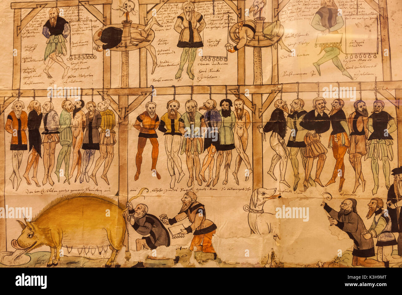 Germany, Bavaria, Romantic Road, Rothenburg-ob-der-Tauber, Kriminal Museum, Medieval Shame and Reprimand Letter depicting Debtor's Punishment - Stock Image