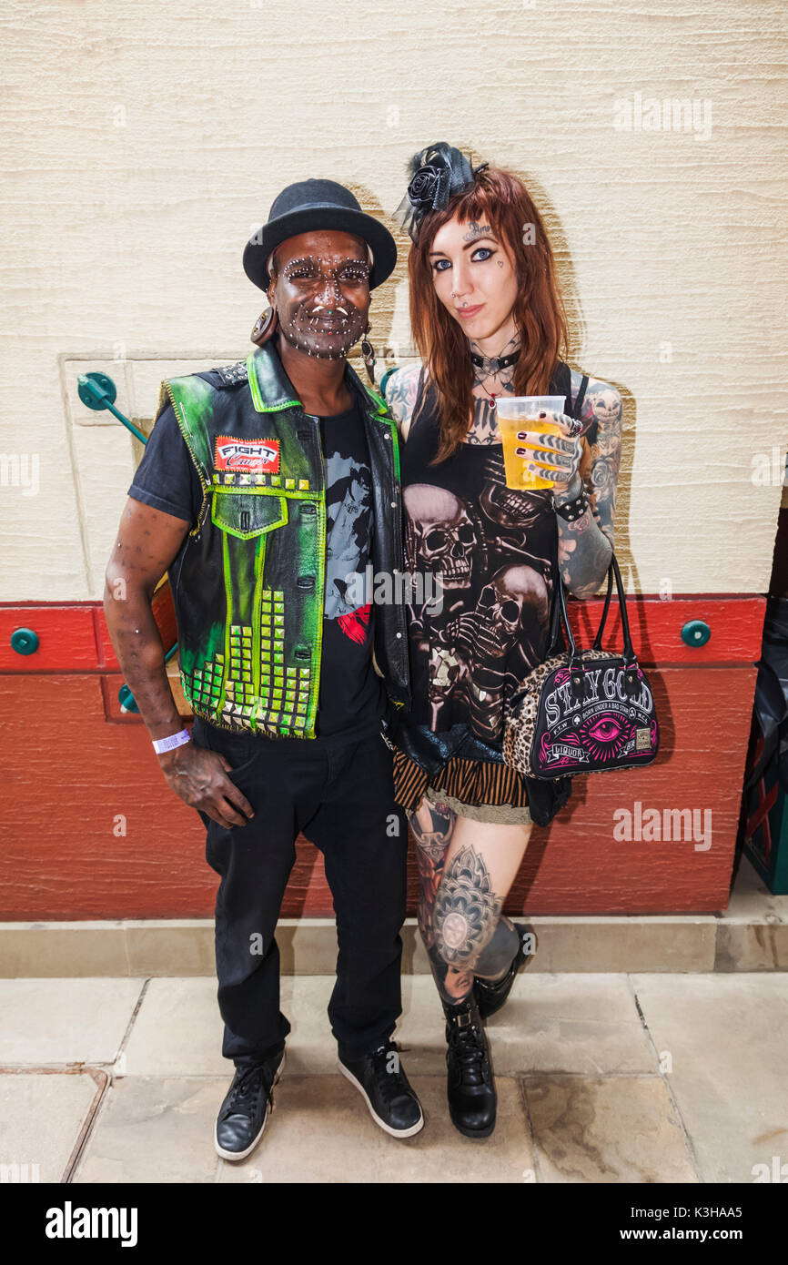 England, London, London Tattoo Convention, Couple with Body Piercing - Stock Image