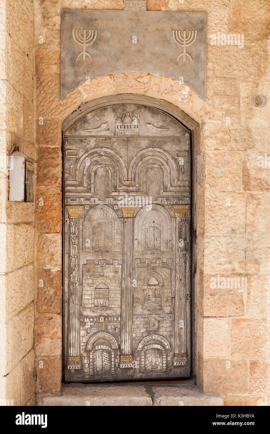 Silver and gold metal door with judaism siymbols and the gates of  jerusalm Stock Photo