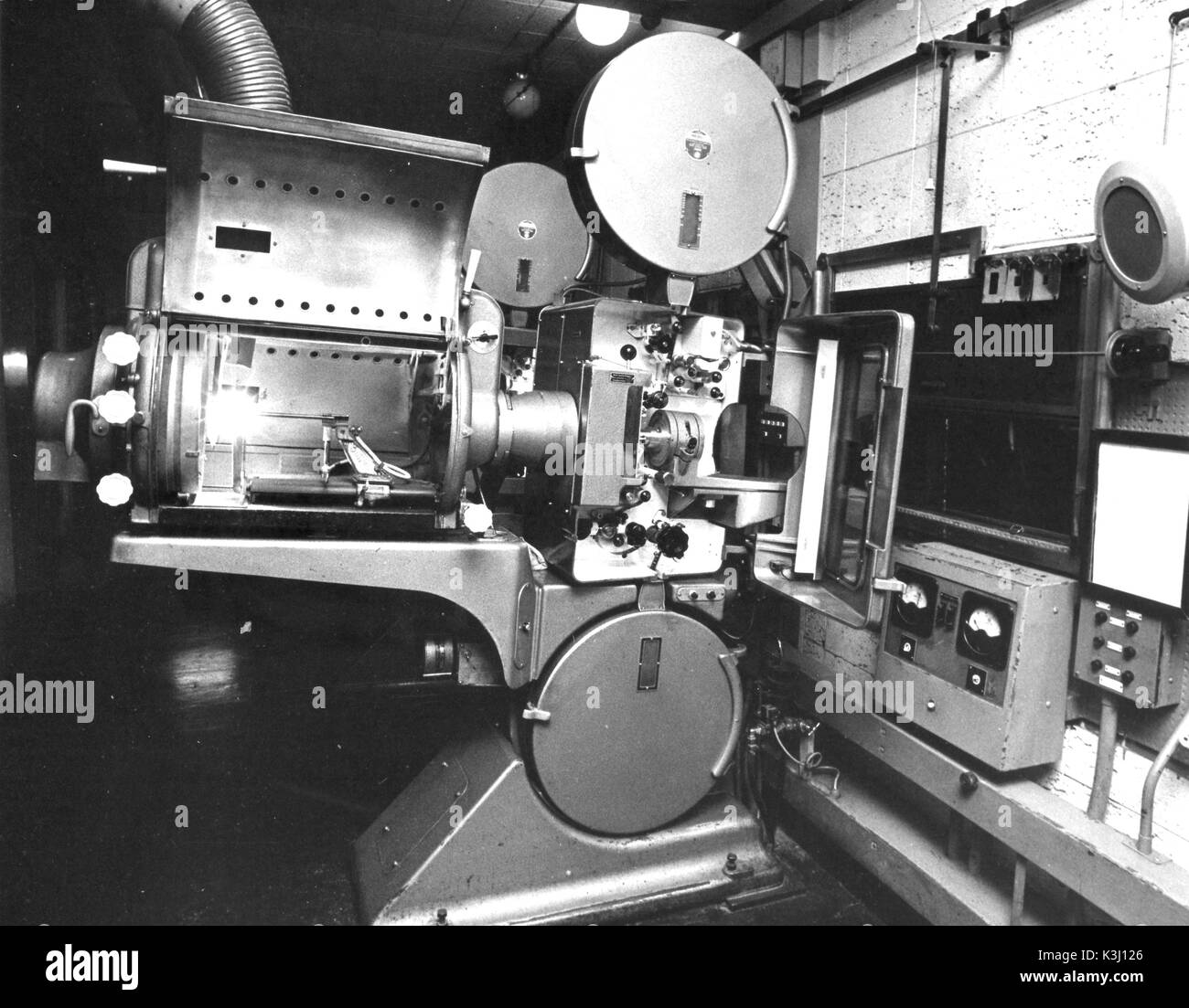 Projection room, showing the Phillips DP70 dual gauge 35/70mm projectors, with Peerless Magnarc carbon arc lamphouses of the COLUMBIA THEATRE, SHAFTESBURY AVENUE, LONDON, the name of the cinema when it opened in 1959. It was later renamed the CLASSIC SHAFTESBURY AVENUE in 1982, the PREMIERE in 1984, and the CURZON WEST END in 1985. It is now known as the CURZON, SOHO at time of writing - Stock Image