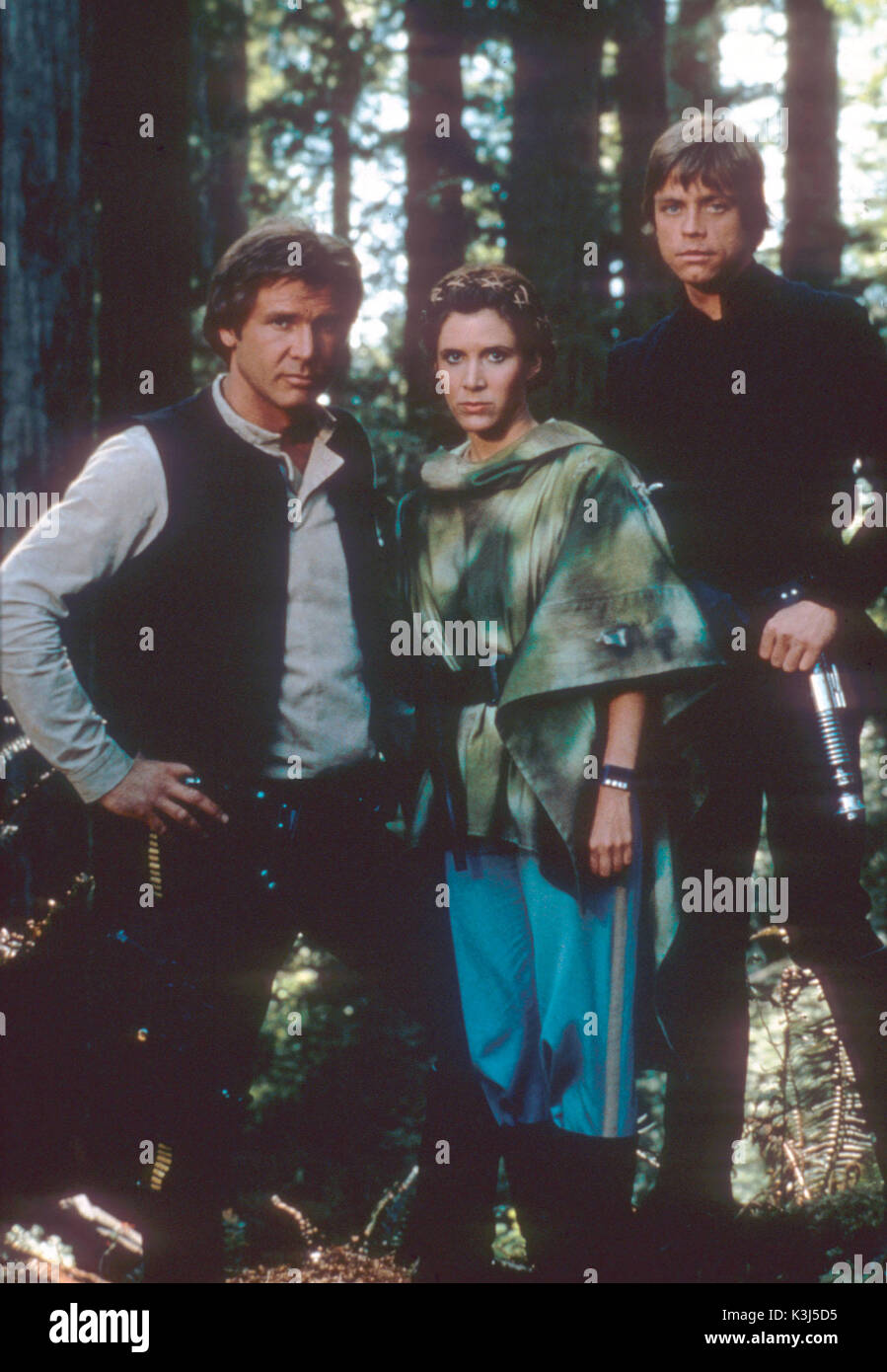 STAR WARS: EPISODE VI - RETURN OF THE JEDI HARRISON FORD as Han Solo, CARRIE FISHER as Princess Leia, MARK HAMILL as Luke Skywalker     Date: 1983 - Stock Image