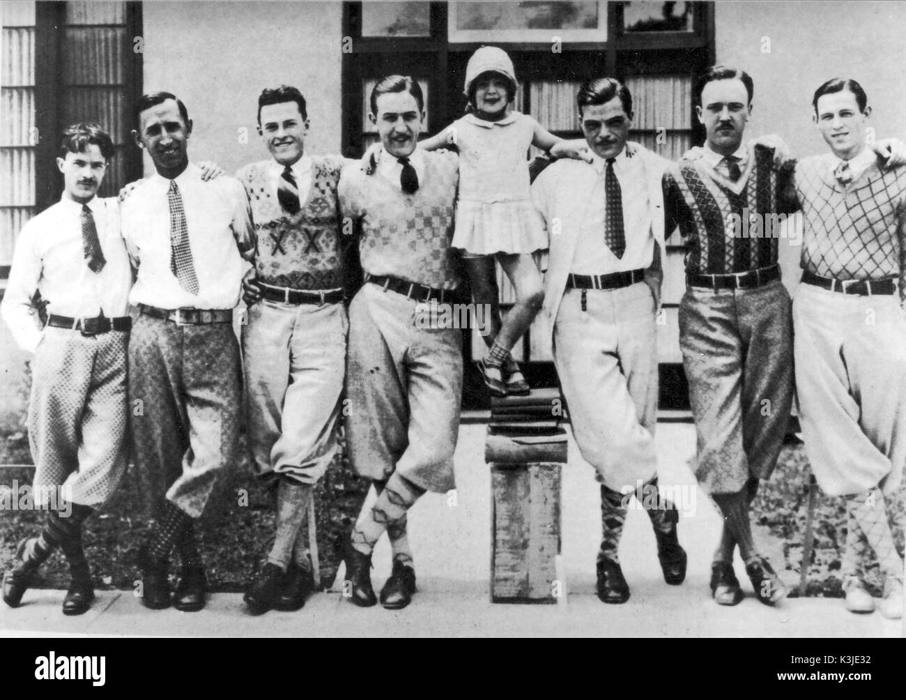 WALT DISNEY and his animators in either late 1926 or early 1927, when they were working on the Alice series of cartoons. HAM HAMILTON, ROY O. DISNEY, HUGH HARMAN, WALT DISNEY, MARGIE GAY who played Alice, RUDOLPH ISING, UB IWERKS, WALKER HARMAN WALT DISNEY and his animators in either late 1926 or early 1927, when they were working on the Alice series of cartoons. - Stock Image