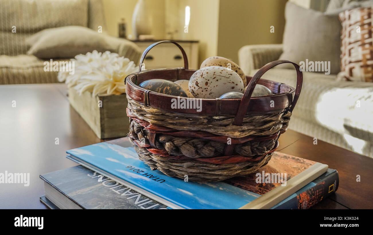 Decorative Eggs in a Wicker Basket, home decor - Stock Image