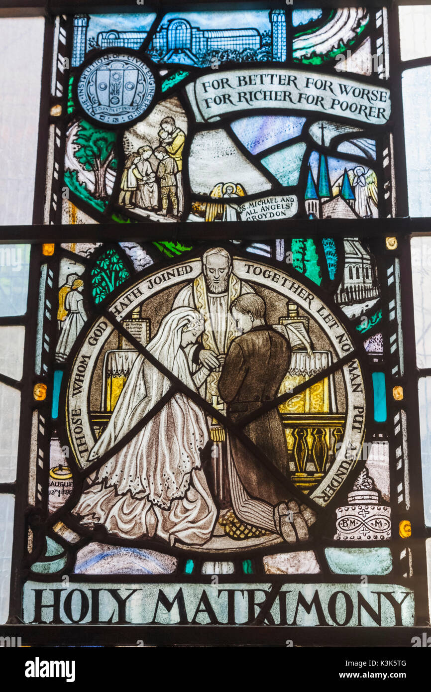 England, London, Wapping, St Peter's London Docks Catholic Church, Stained Glass Window depicting Marriage Ceremony Stock Photo