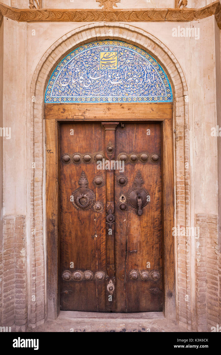 Iran, Central Iran, Kashan, Khan-e Boroujerdi, traditional carpet merchant's house, ornate door with door knockers for male and female guests - Stock Image