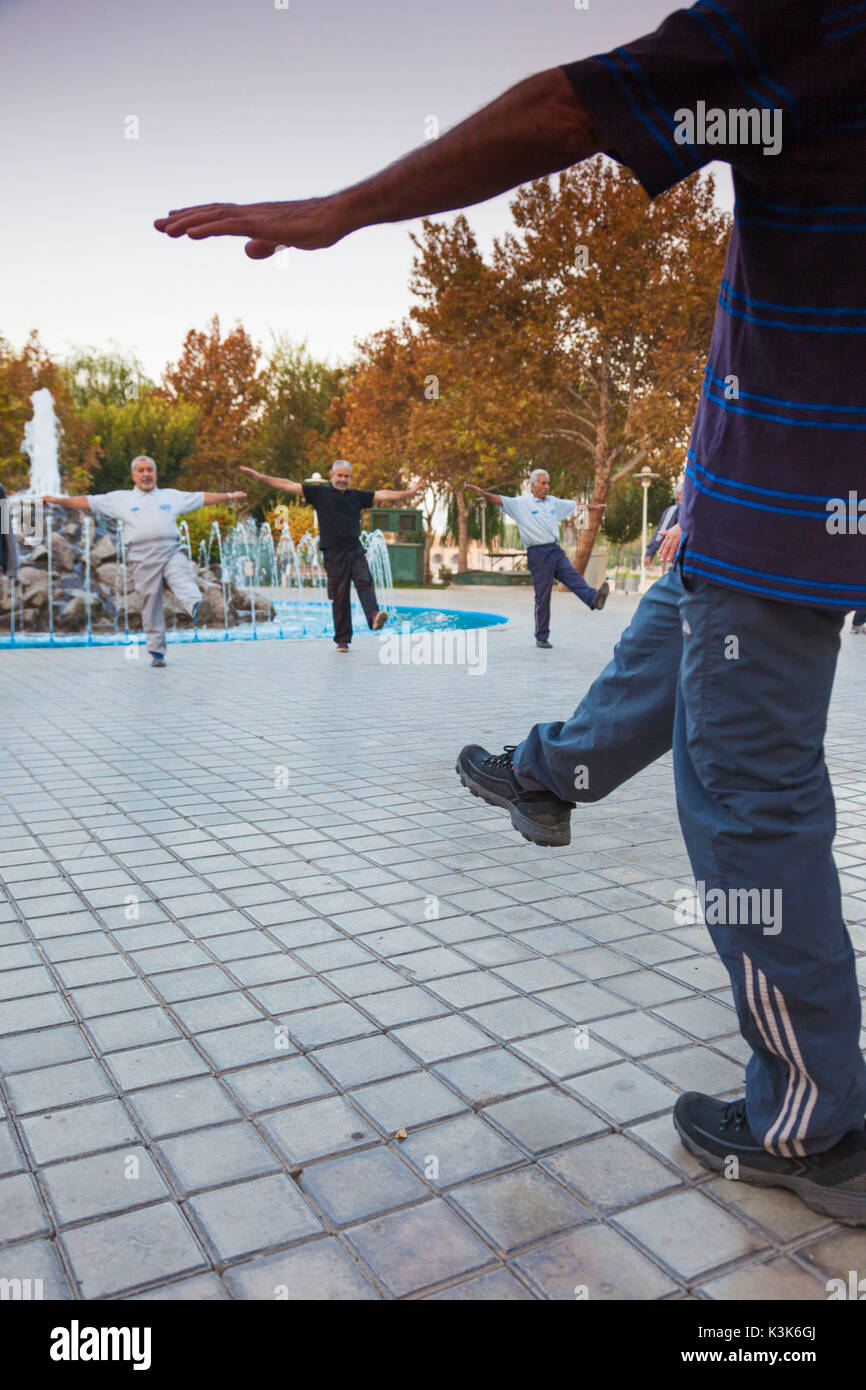 Iran, Central Iran, Esfahan, older men excercising by the river - Stock Image