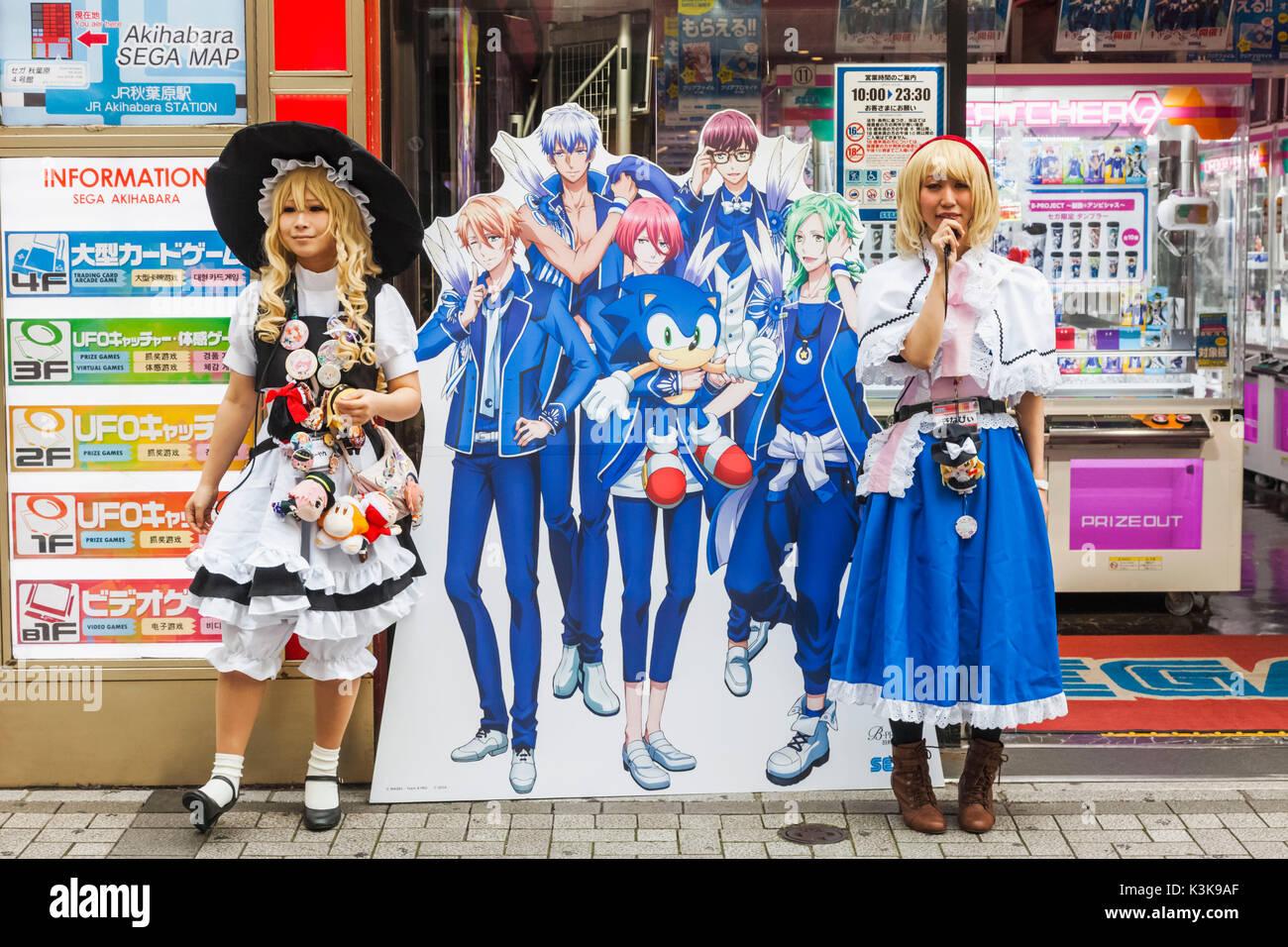 Japan, Hoshu, Tokyo, Akihabara, Gaming Centre Entrance, Girls Promoting New Games - Stock Image