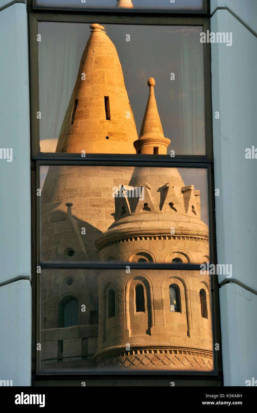 Hungary, Budapest, Fisherman's Bastion reflecting on Hilton Hotel 's windows located in the historical Buda Castle Stock Photo