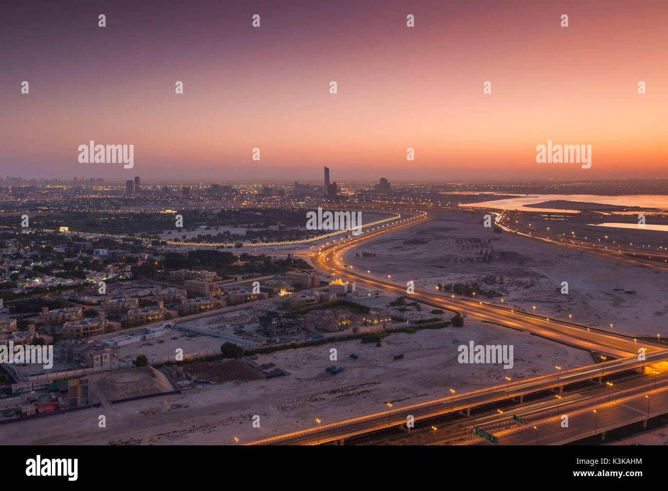 UAE, Dubai, Downtown Dubai, elevated desert and highway view towards Ras Al Khor, dawn - Stock Image