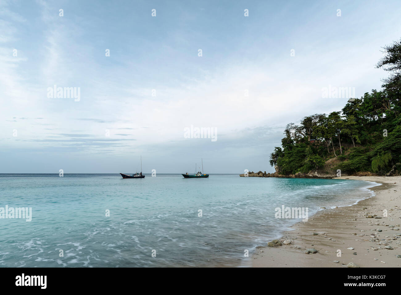 Two fishing boats in a small lagoon on the beach of the Fantastically nice island Pulau woe in Indonesia. Stock Photo