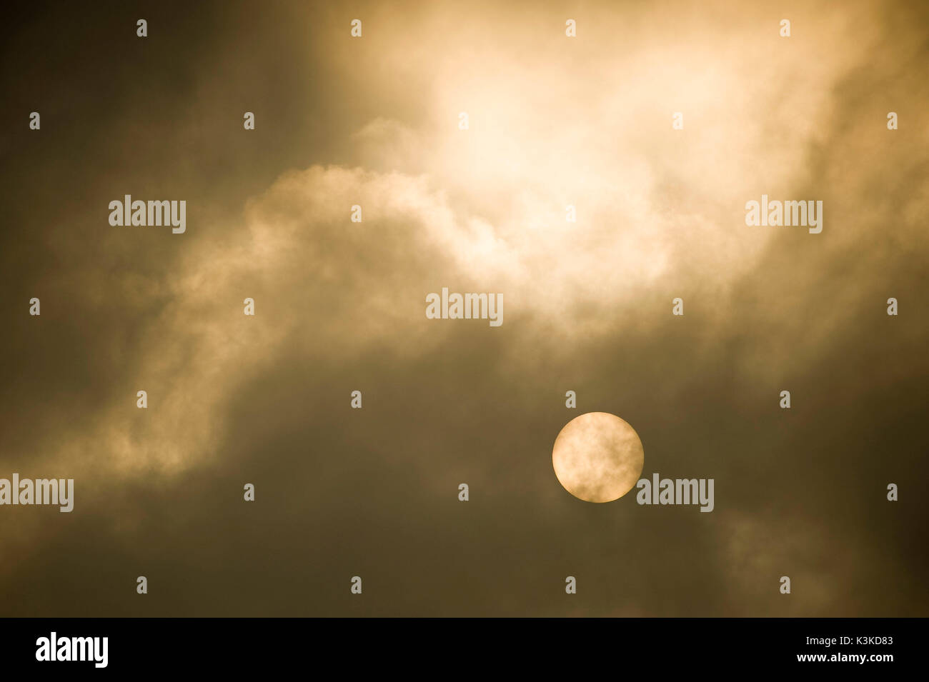 The sun concealed behind clouds - Stock Image