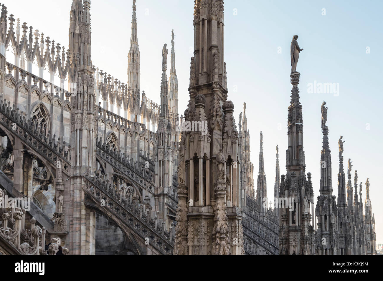 On the rooftop of the Duomo di Milano, among the white marble spiers, Milano, Lombardy, Italy. - Stock Image