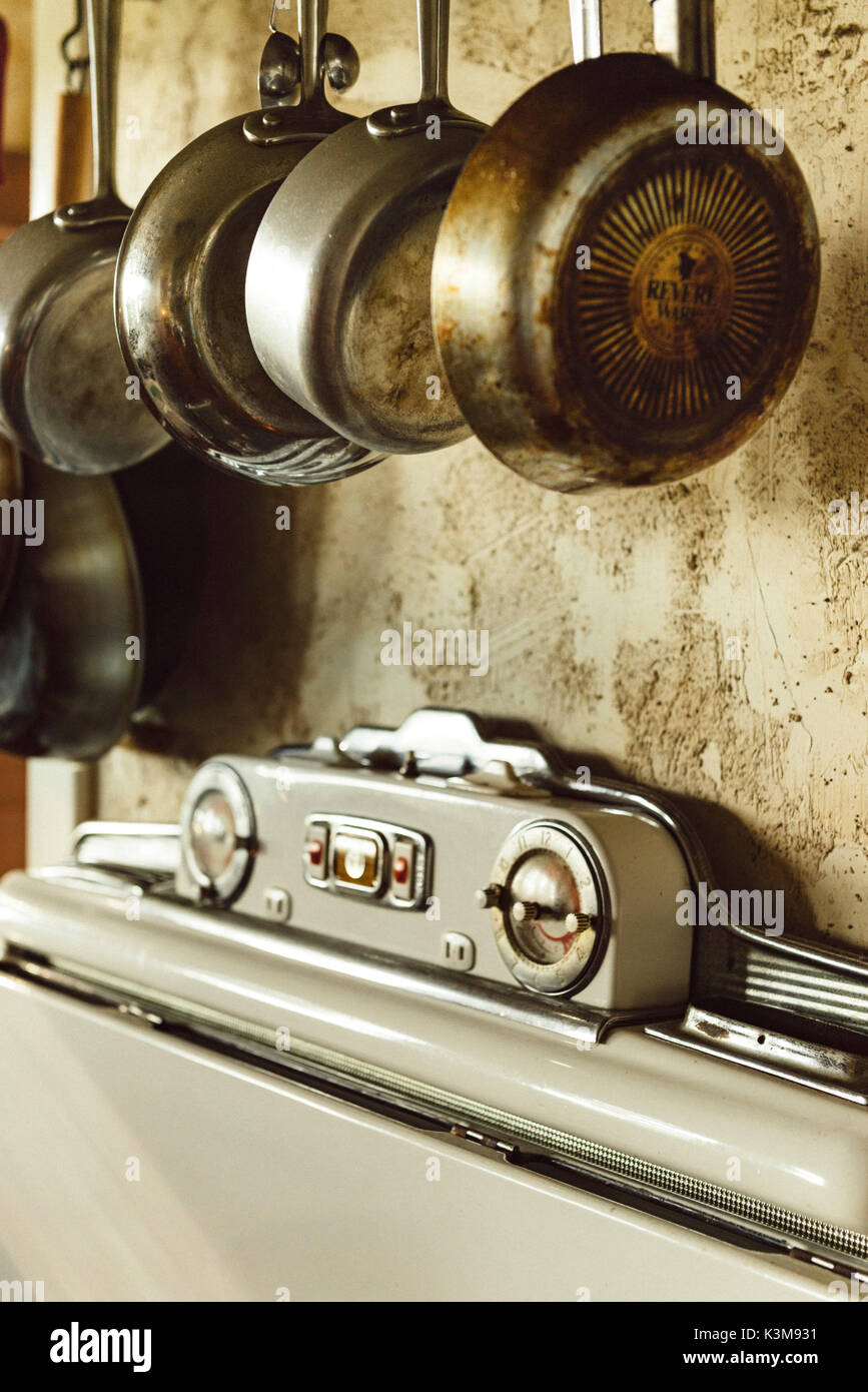 old stove, hanging pans Stock Photo