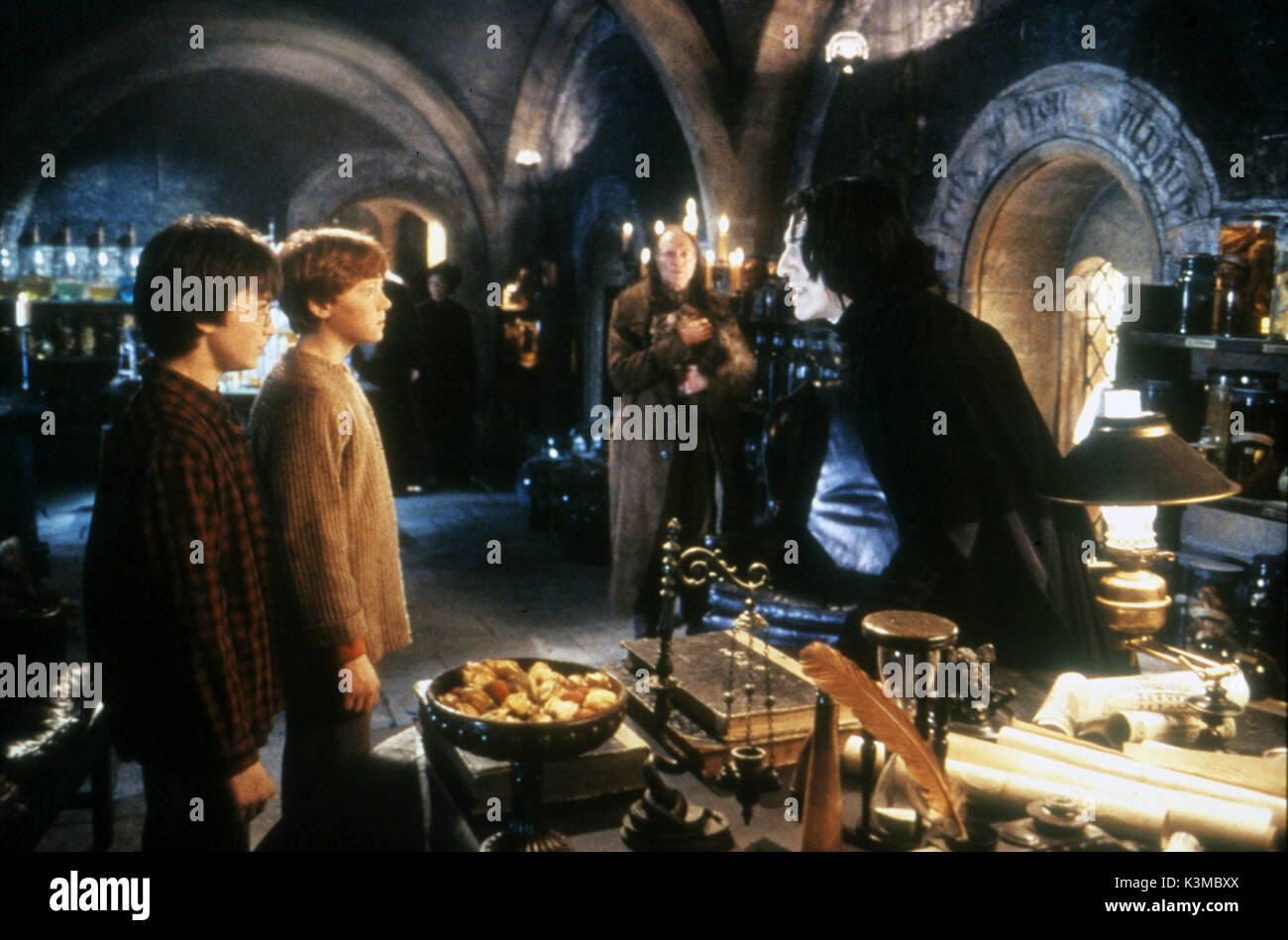 HARRY POTTER AND THE CHAMBER OF SECRETS [BR / US / GER 2002] [L-R] DANIEL RADCLIFFE as Harry Potter, RUPERT GRINT as Ron Weasley, DAVID BRADLEY as Argus Filch, ALAN RICKMAN as Severus Snape     Date: 2002 - Stock Image