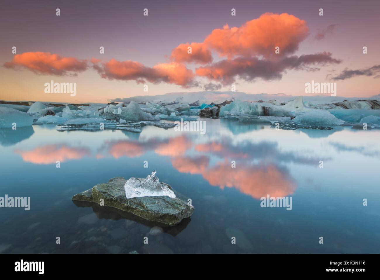Jokulsarlon, Eastern Iceland, Iceland, Northern Europe. The iconic little icebergs lined on the black sand beach. Stock Photo