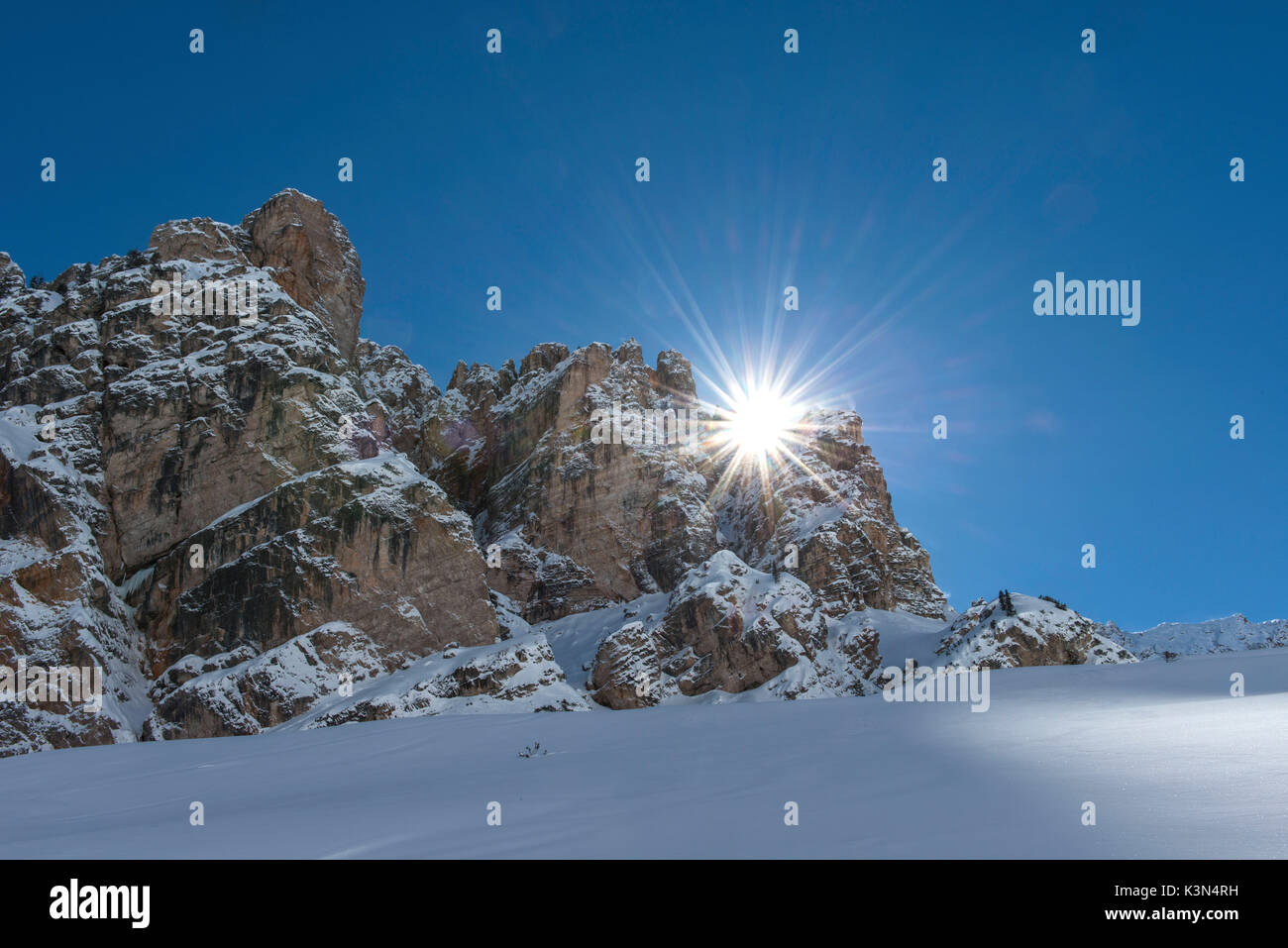 Fanes, Dolomites, South Tyrol, Italy. The sun rises behind the peaks of Piciodel - Stock Image