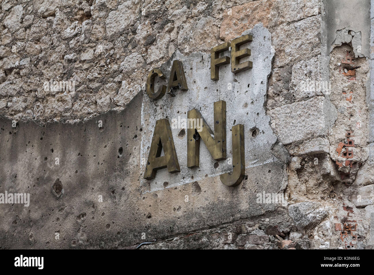 Eastern Europe, Mostar, Bosnia and Herzegovina.  The marks of war in the Balkans on the walls of the city. - Stock Image