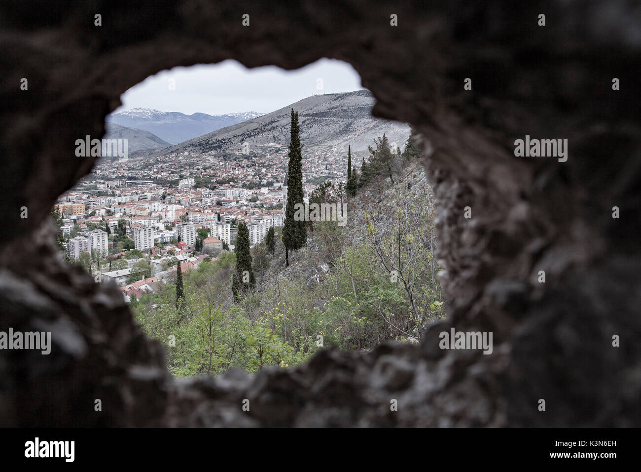 Eastern Europe, Bosnia and Herzegovina. Mostar view from the hole of a bomb of the war in the Balkans - Stock Image