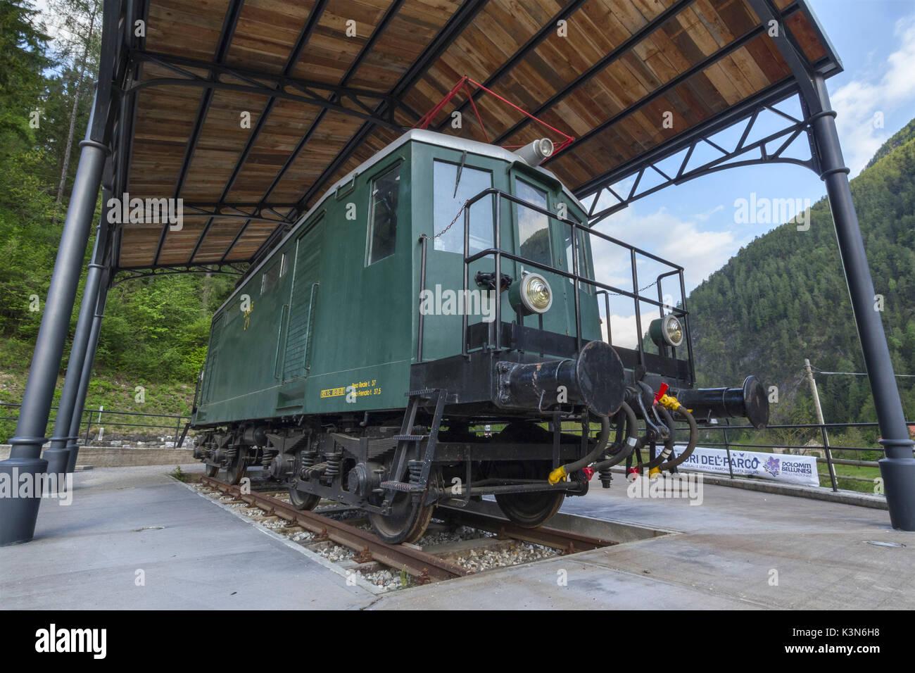 Europe, Italy, Veneto, Agordino. The old locomotive LB1 SAIF of the line  Bribano - Agordo exposed in the mining area of Valle Imperina Rivamonte Agordino, Dolomites - Stock Image