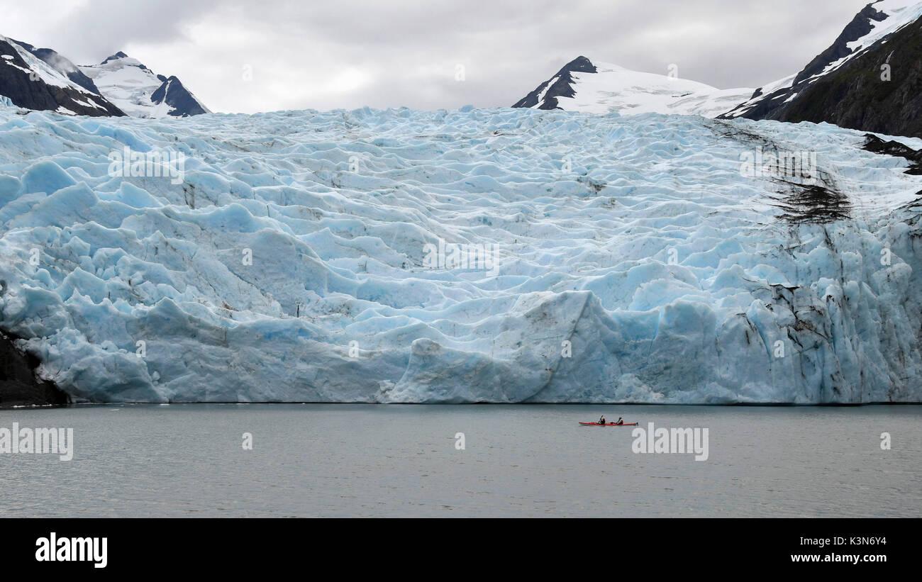 Red canoe close to Portage glacier, Alaska,USA - Stock Image
