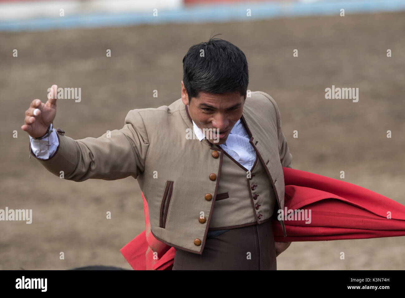 June 18, 2017 Pujili, Ecuador: bullfighter holds up his arm gloriously a moment after the sacrifice of the bull in the arena - Stock Image