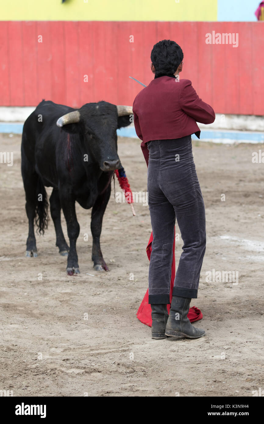 June 18, 2017 Pujili, Ecuador: bullfighter holds up his sword towards the bull during the ritual moments before Stock Photo