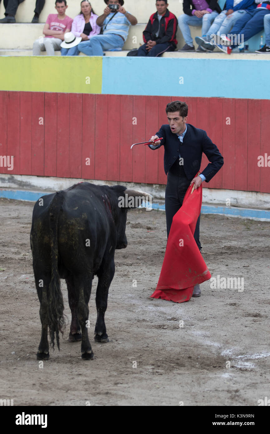 June 18, 2017 Pujili, Ecuador: bullfighter holds up his sword towards the bull during the ritual moments before the sacrifice - Stock Image