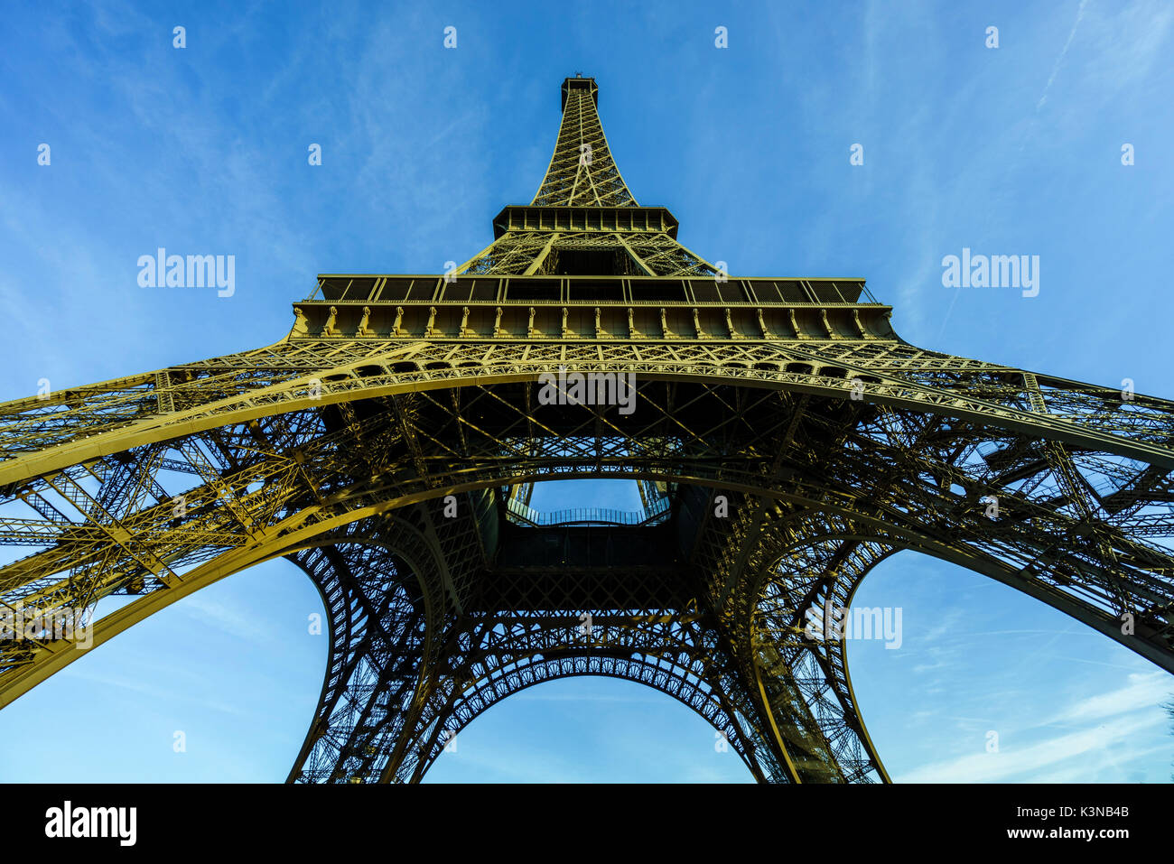Perspective of the Eiffel Tower looking upward toward its top spire, Paris, France - Stock Image