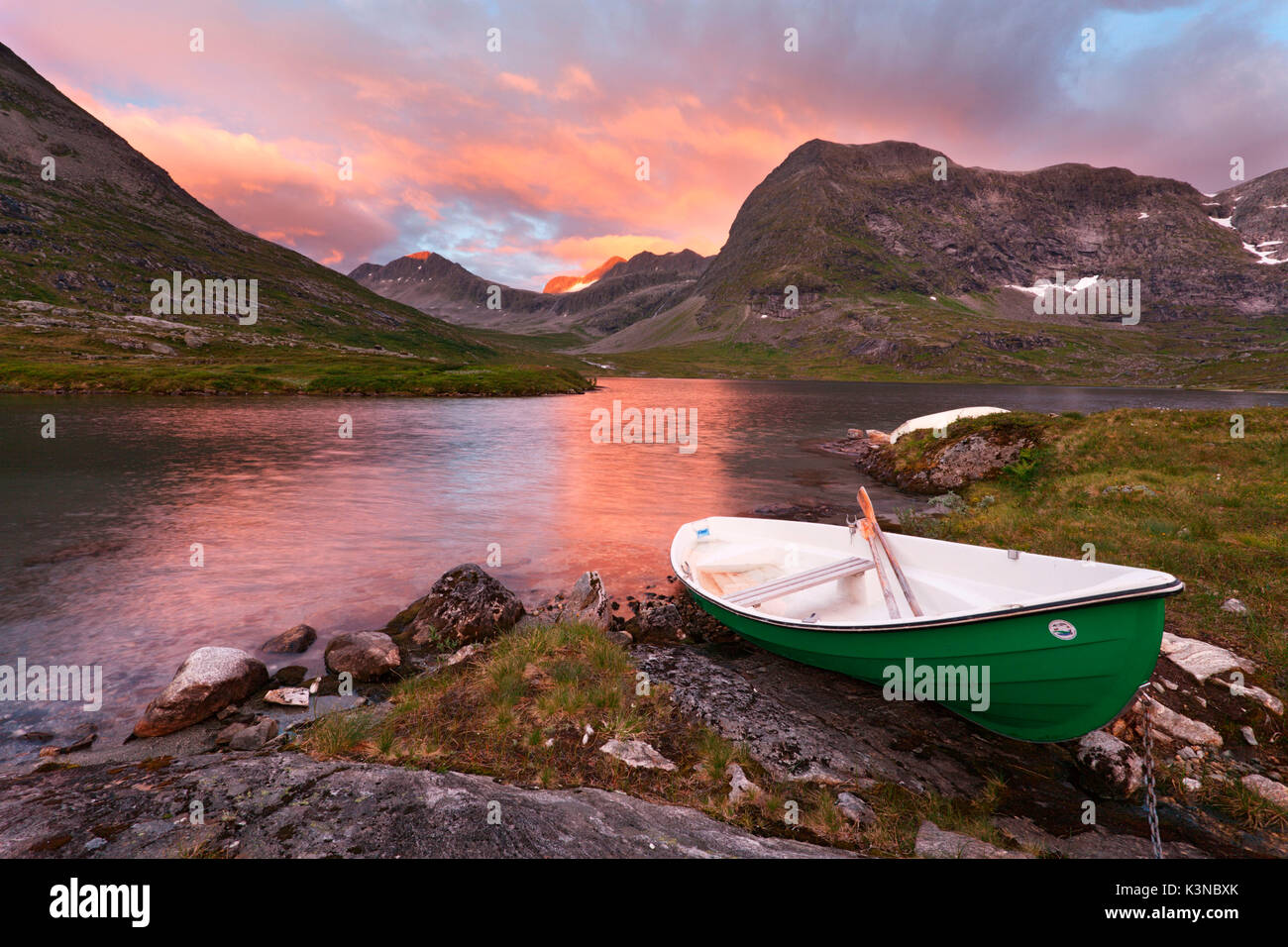 Trollstigen, Norway. Sunset with boat near the Troll Road. - Stock Image