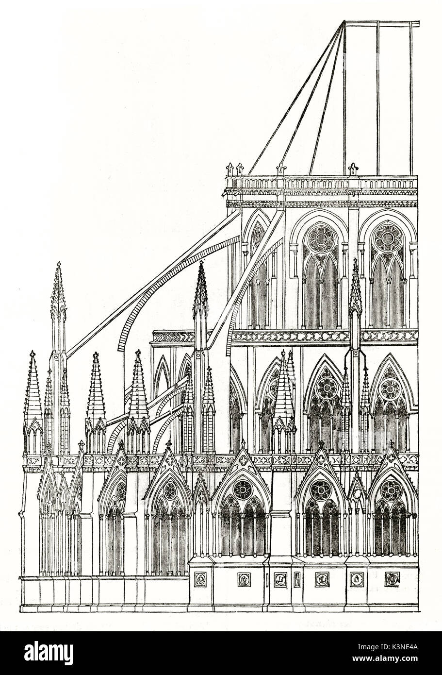 ancient detail of Notre-Dame cathedral apse exterior with his typical pointed arches, windows and spears. Paris, Stock Photo