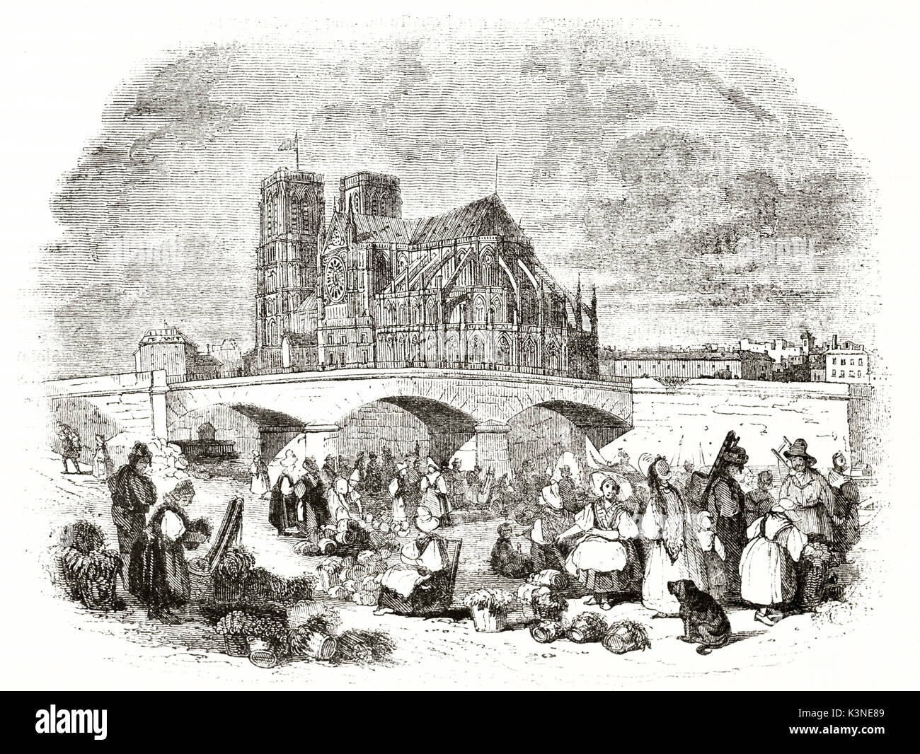 Ancient outdoor fruit market full of people in a Paris square. Notre Dame Cathedral on background. By unidentified author, published on Magasin Pittoresque, Paris, 1839 - Stock Image