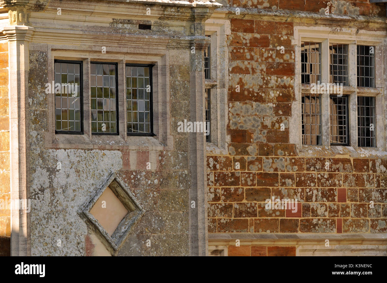 16th century manor houses windows and stonework window tax period property blocked out bricked up widows wolverton Stock Photo