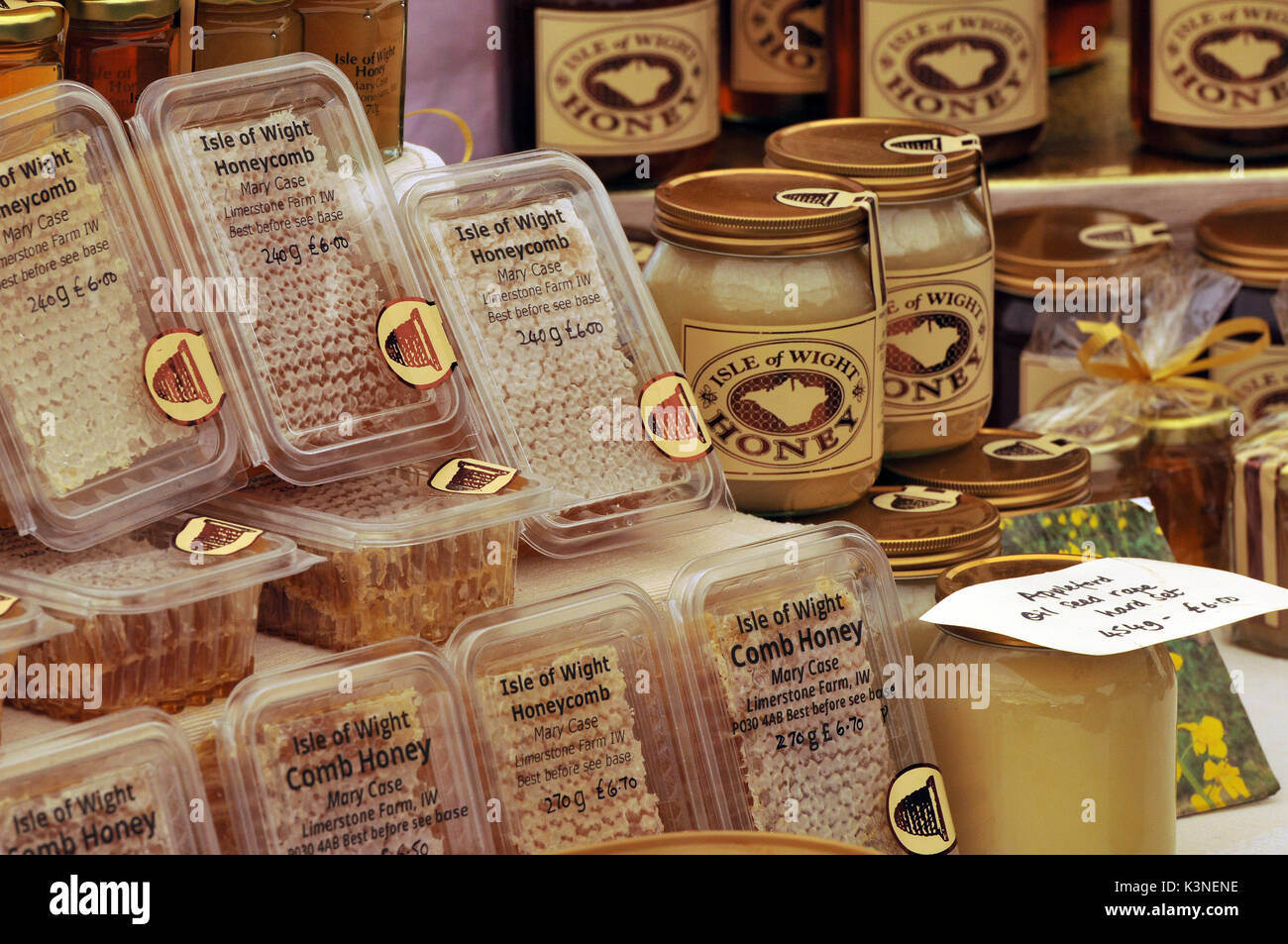 hone for sale at a craft tent at a show in the summer on the isle of wight home made honey from local beekeepers in jars or honeycombs naturally good - Stock Image