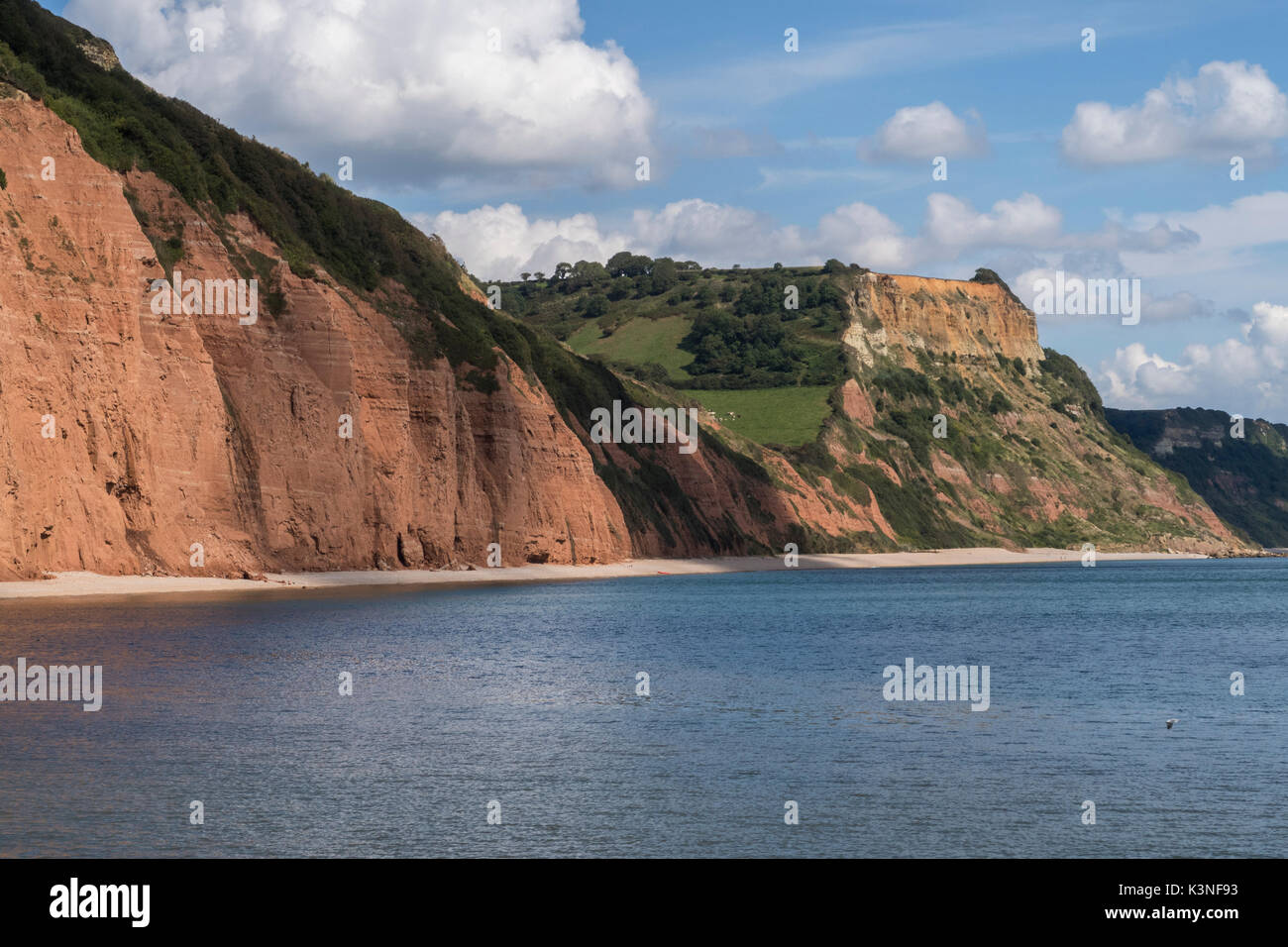 Red sandstone triassic cliffs at Salcombe mouth, Sidmouth, Devon. - Stock Image
