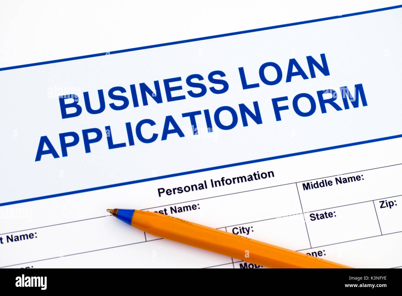 Business Loan Application Form with ballpoint pen. Stock Photo