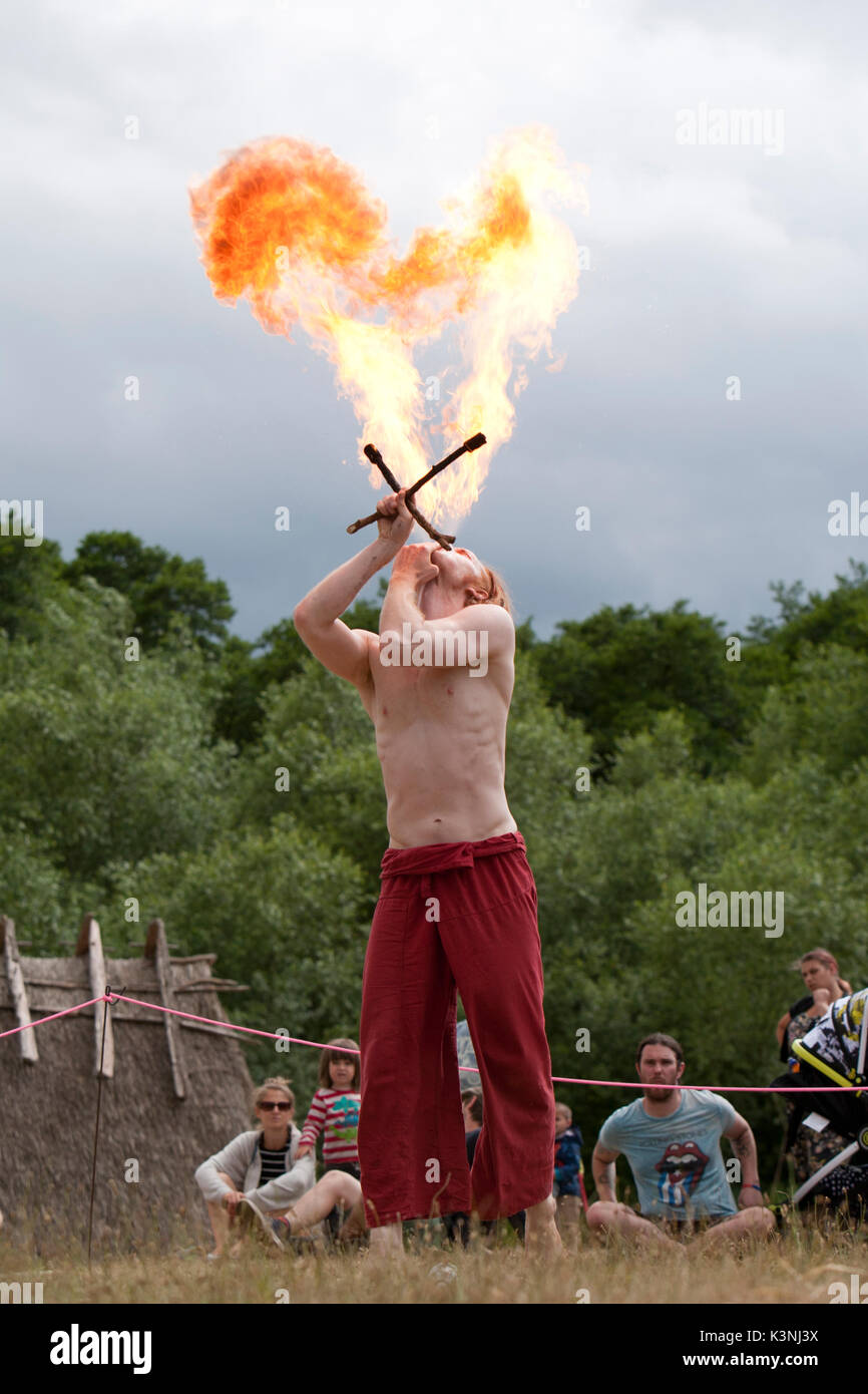 Fire breather, Farren, wows visitors to Dragon Fest 2017, hosted by West Stow Anglo Saxon Village in Norfolk, England. - Stock Image