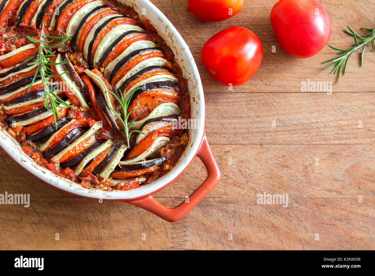 Ratatouille - traditional French Provencal vegetable dish cooked in oven. Diet vegetarian vegan food - Ratatouille casserole. - Stock Image