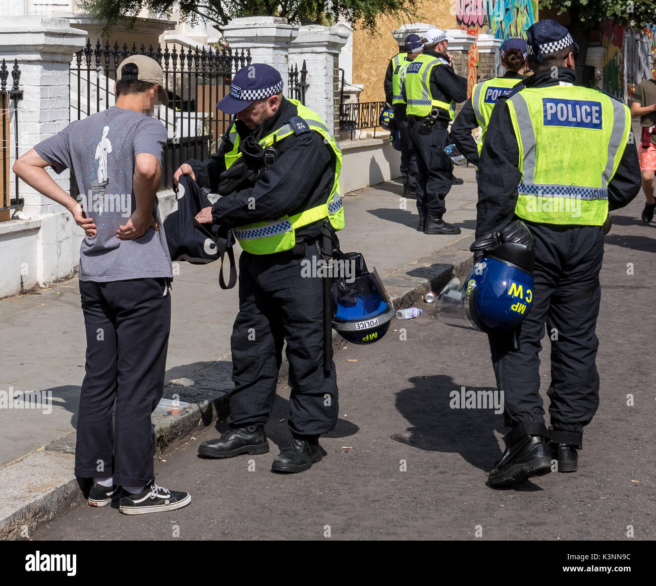 London, UK. 28th August 2017. Police perform stop and search on suspects during Notting Hill Carnival 2017© Guy Corbishley / Alamy Live News - Stock Image