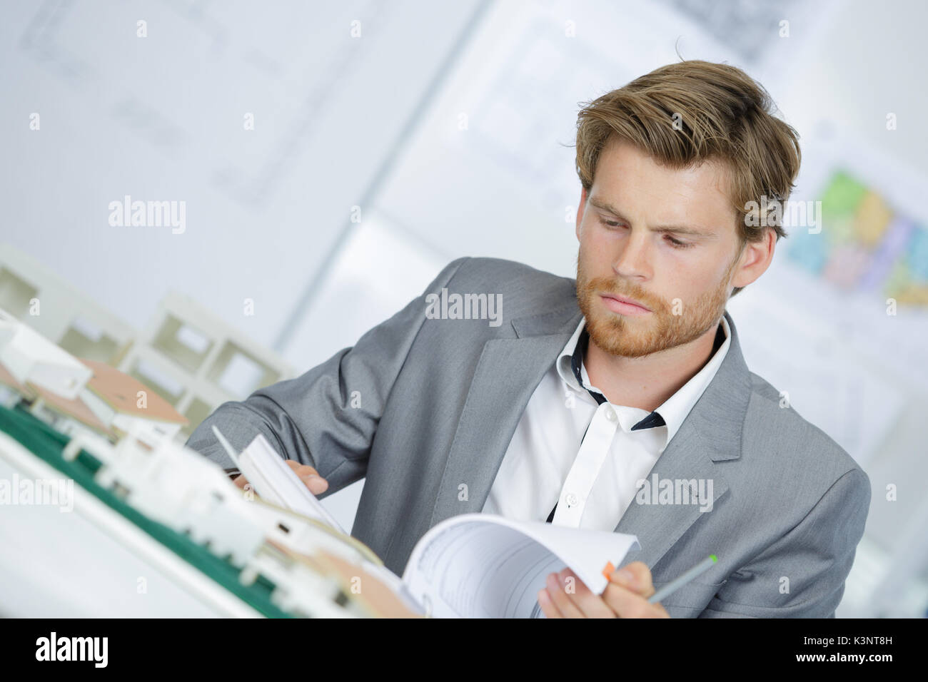 architect with models and his office desk - Stock Image