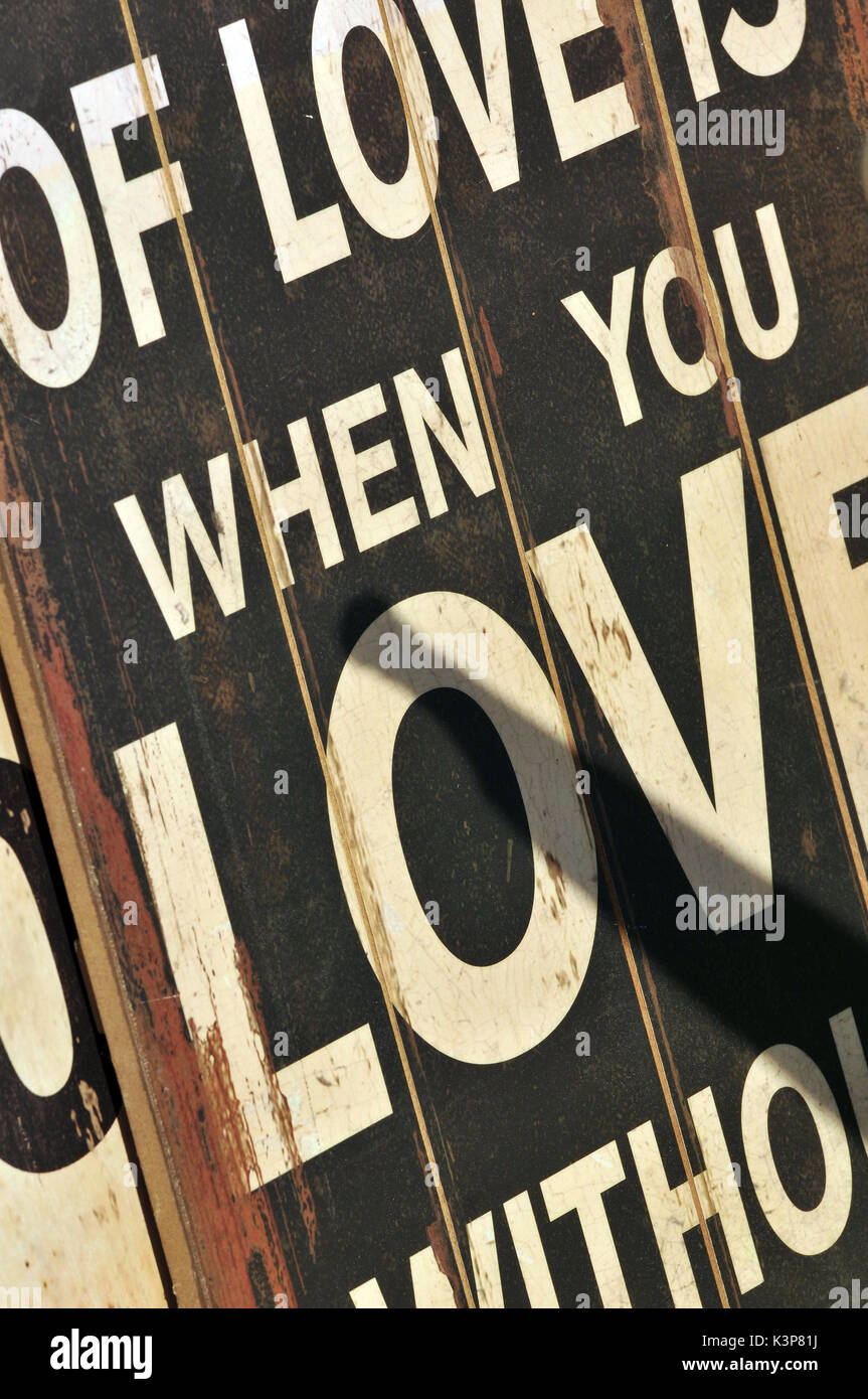 Love poster advertising love relationships loving somebody in love with partners wall hanging placard poster love loving loves - Stock Image