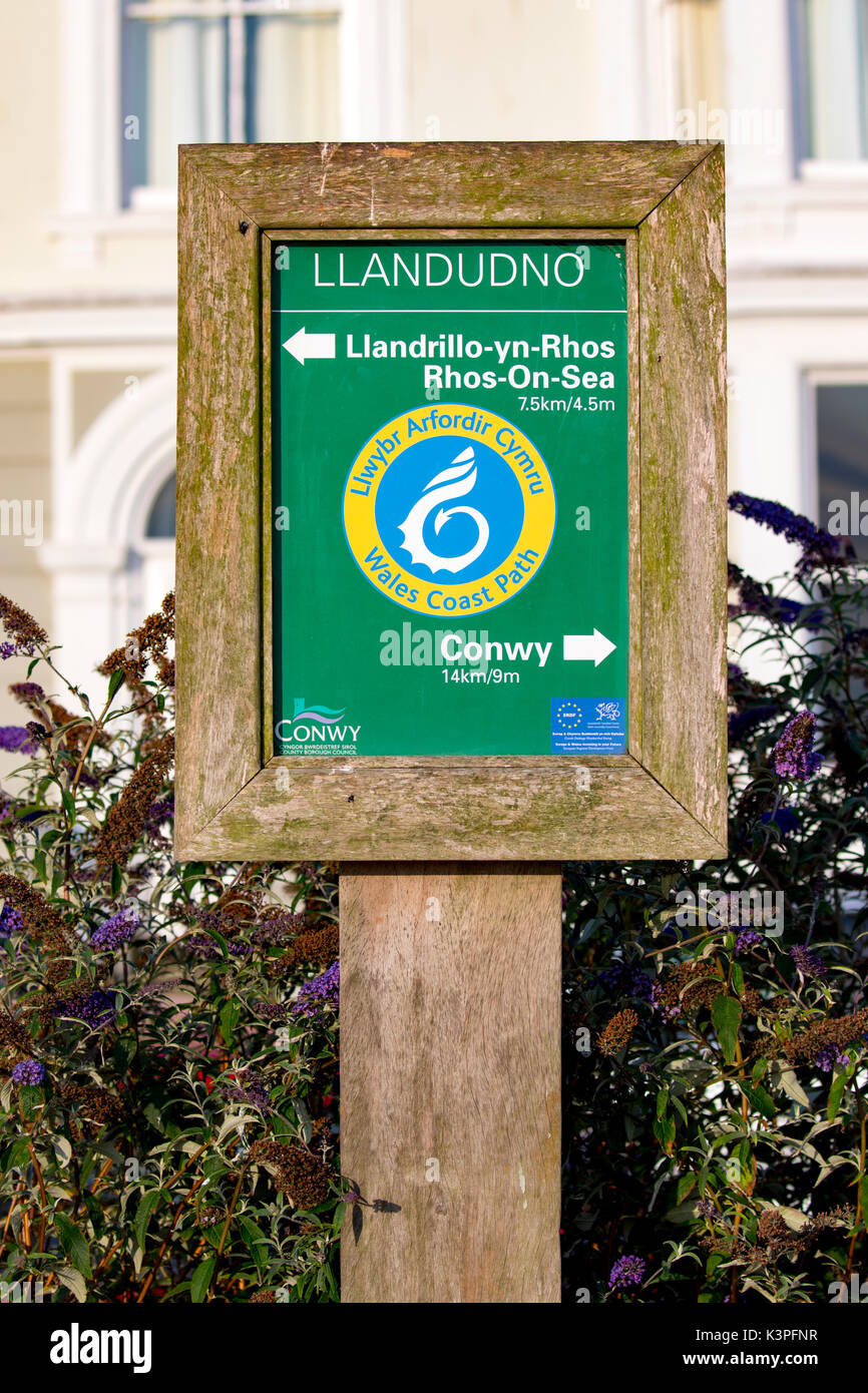 Wales Coast Path sign showing directions to Conwy and LLandrillo-yn-Rhos or Rhos-on-Sea at Llandudno in North Wales, Stock Photo