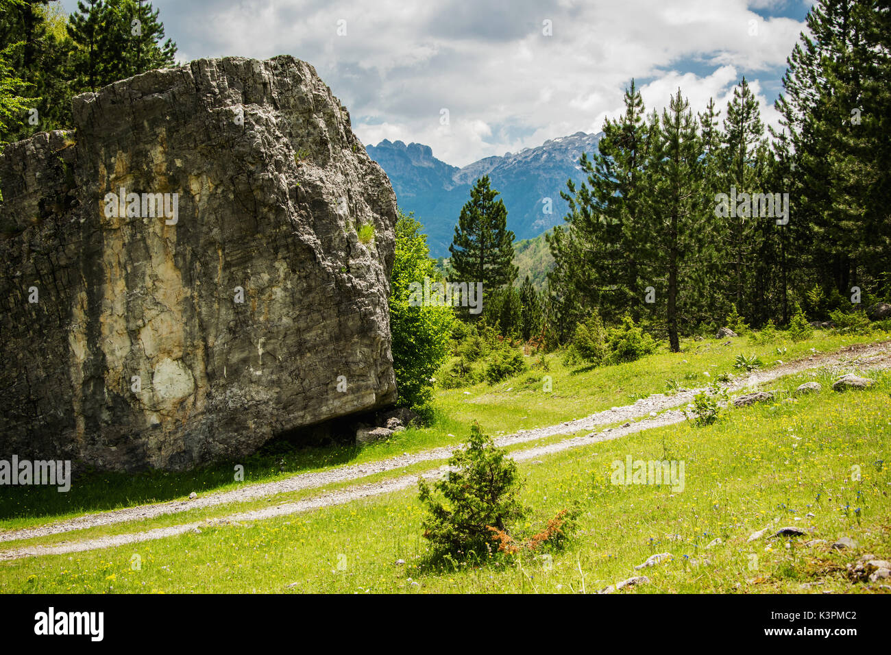 Scenic nature view - a  huge rock next to the road. Concept of moving a huge stone from the road - Stock Image
