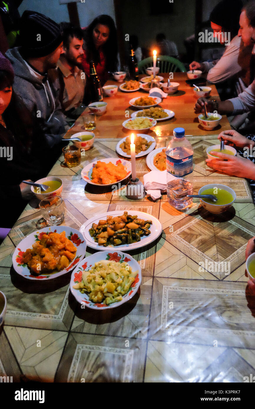 Hungry hikers eat dinner after a day trekking on the Kalaw to Inle Lake track Stock Photo